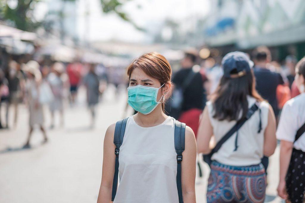 bigstock young asian woman wearing prot 348738442